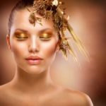 Golden Makeup. Luxury Fashion Girl Portrait